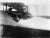 French pilot Roland Garros and dog in biplane