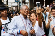 PDRC's leader Suthep Thaugsuban has a selfie taken with a protester