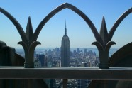 View of Empire State Bldg through the railing Atop of the Rock